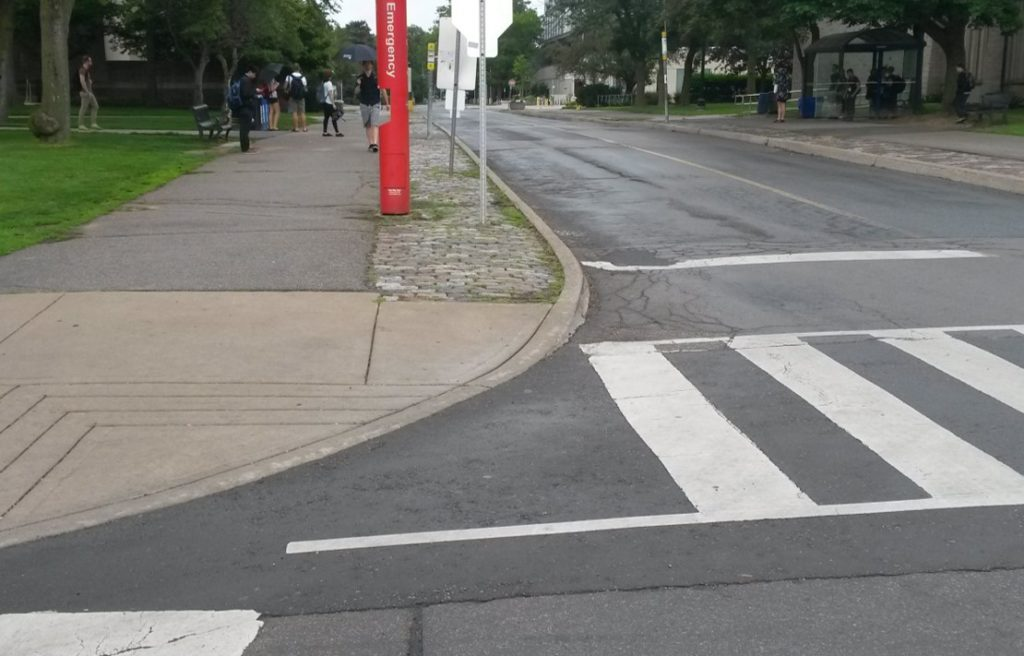 Curb cut by the campus bus stop on Sterling Street